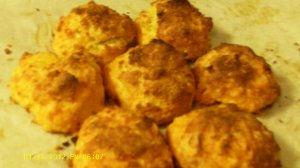 image of gluten-free garlic cheddar biscuits on parchment paper